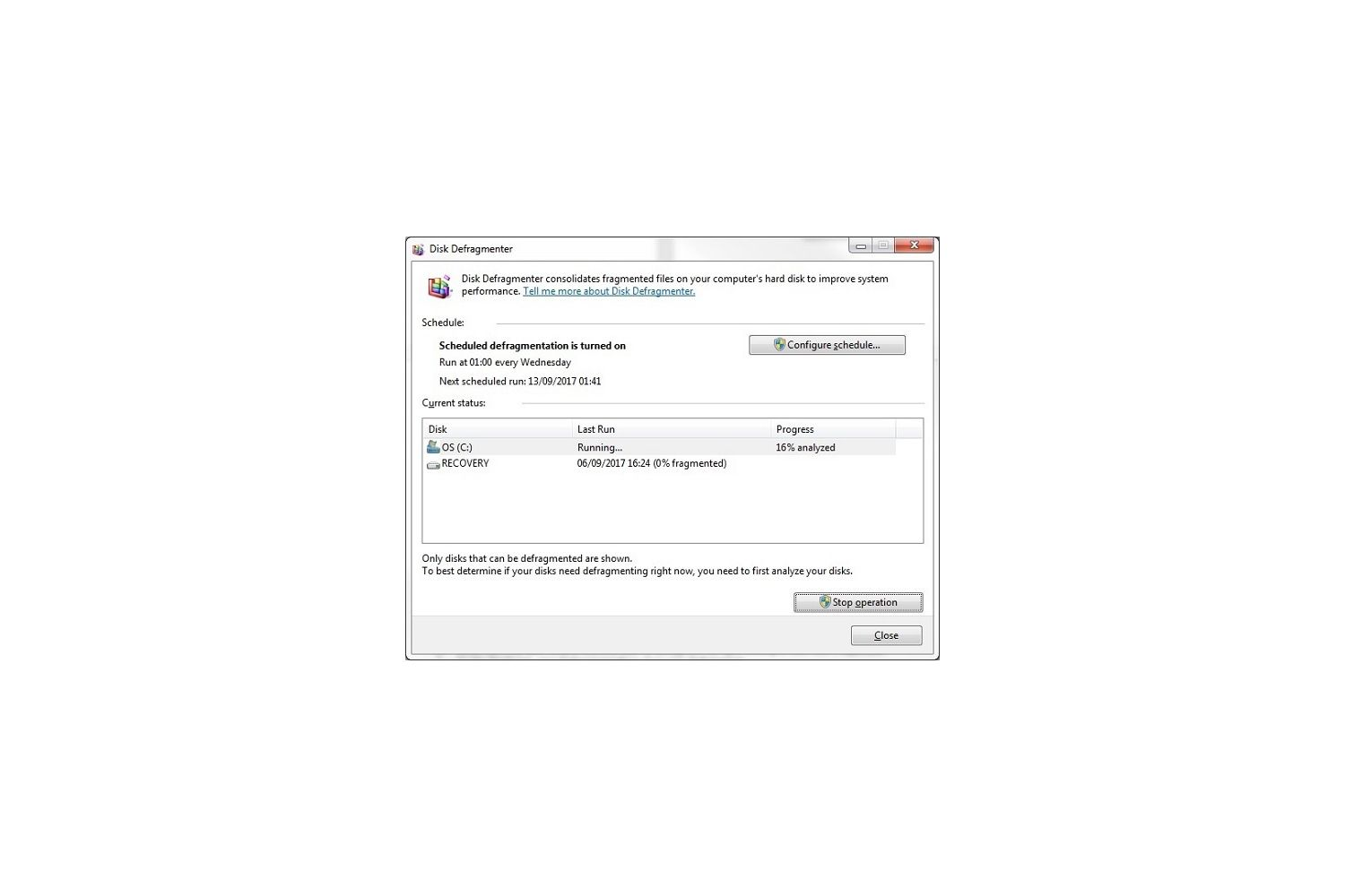 Windows 7 Disk Defragmenter pop-up window reports current analysis status of a disk analysis report