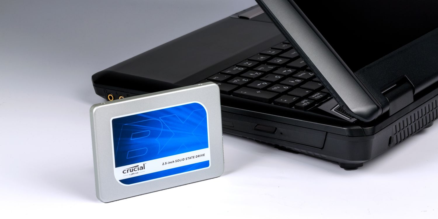 A Crucial SSD drive and a laptop.