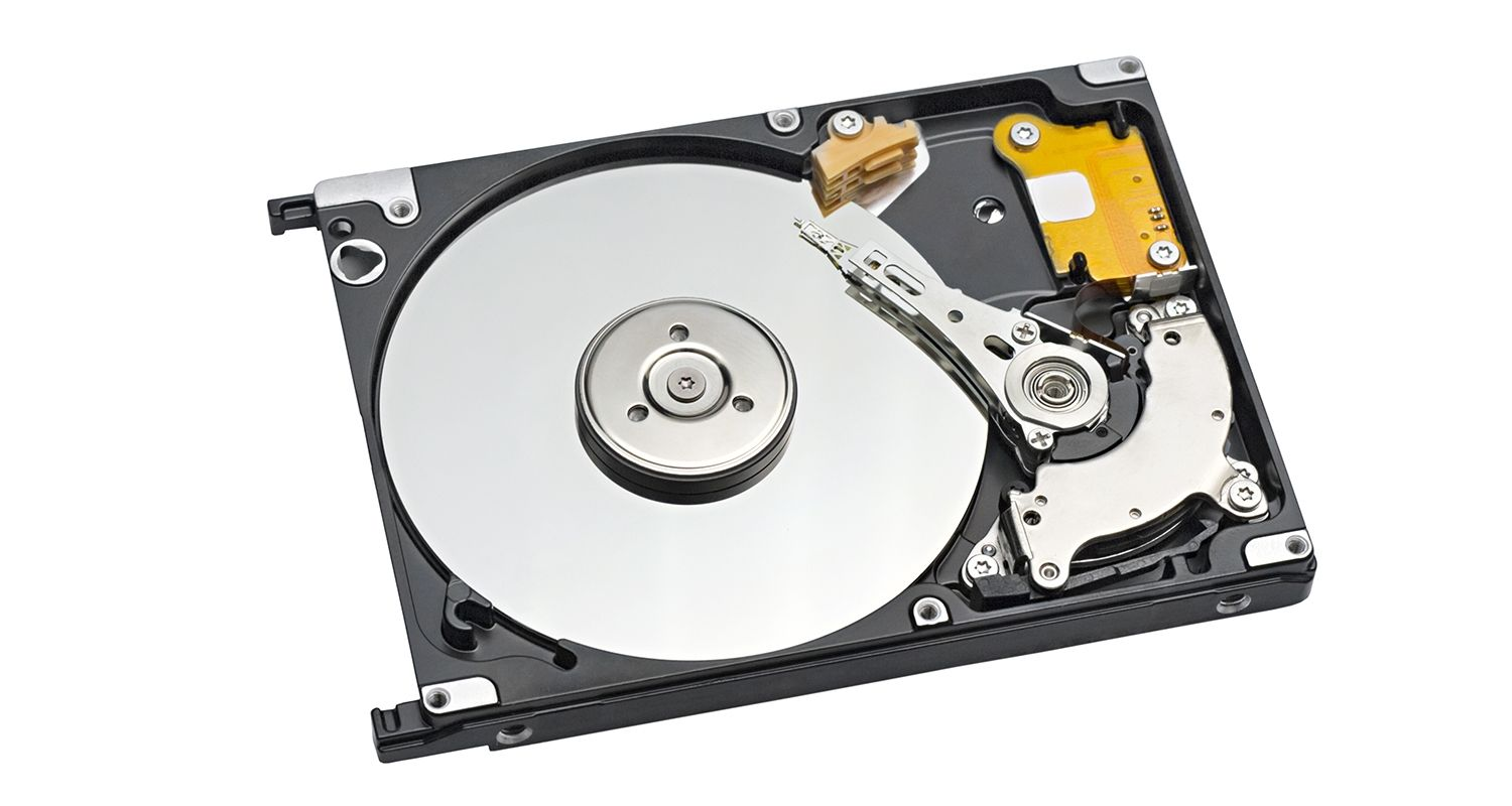 Hard drive showing spinning platter and actuator arm.