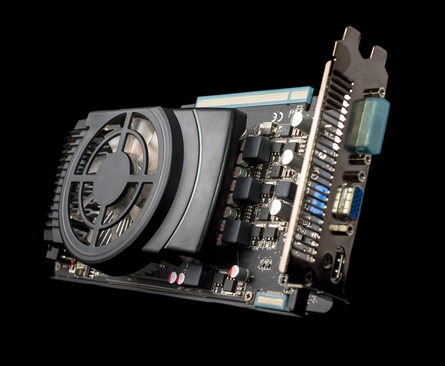A close up up of a graphics card is isolated against a black background