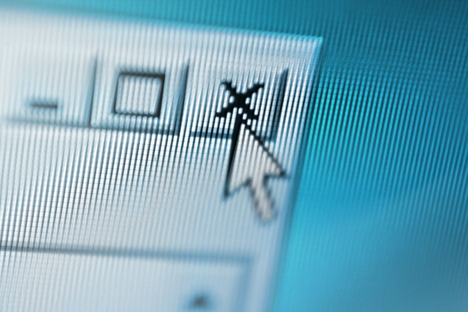 Close up of a computer screen whereby a mouse pointer is closing a suspicious pop-up window