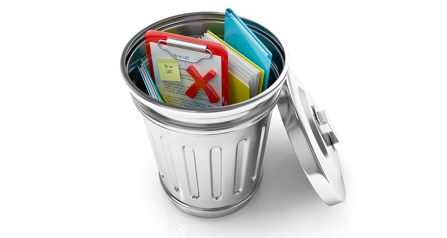 An open trash can contains discarded documents and data files representing a user deleting their cookies and temporary internet browser files
