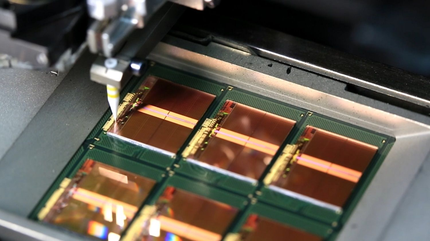 Thin gold wires connect the bonding pads on the chips to the frames as part of the memory production process