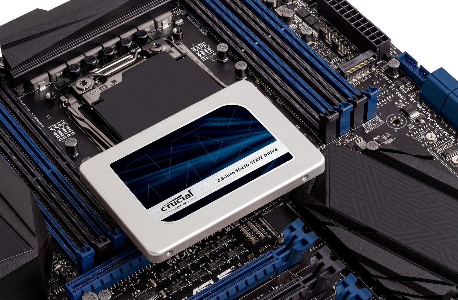 A Crucial SSD placed on top of a motherboard