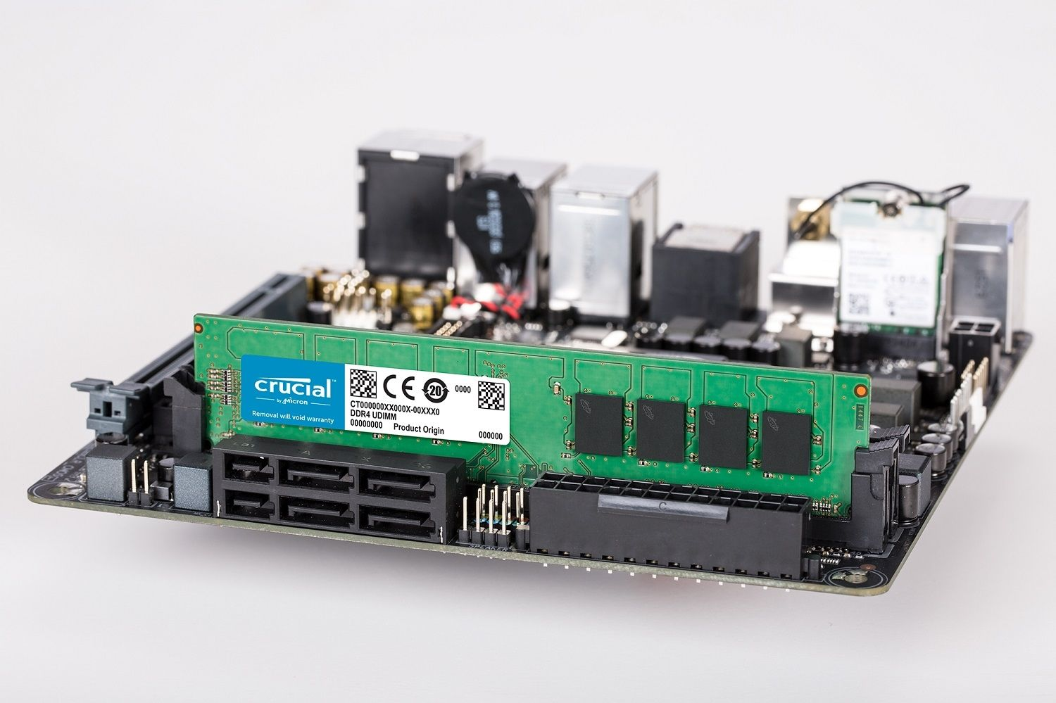 A Crucial DDR4 UDIMM RAM memory module in position on a pc's motherboard