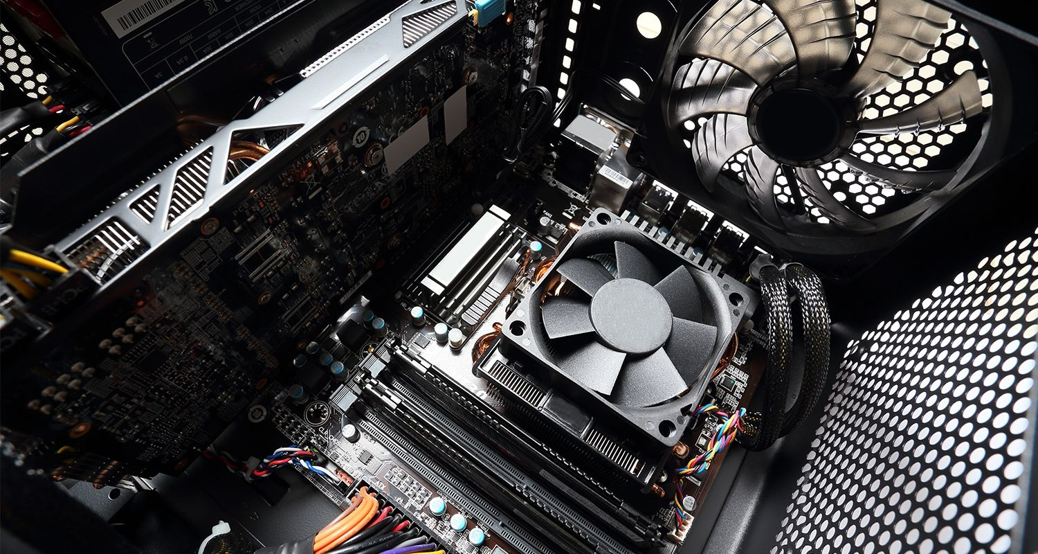 The inside of a computer, including a computer fan.